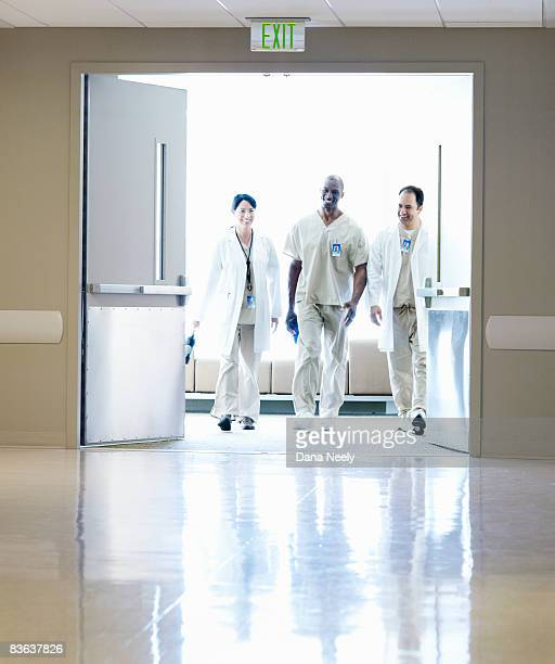 Group of doctors walking in hospital, motion blur