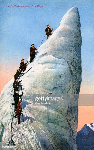 A group of early mountain climbers ascending a glacial ice column or Serac in the Alps handcolored photograph 1913