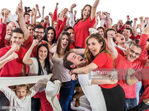 Group of ecstatic fans celebrating.