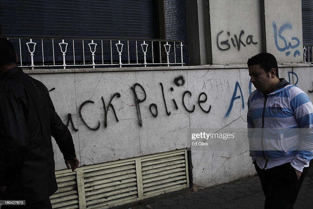 A group of Egyptian men walk by graffiti on the walls of a luxury hotel damaged during earlier clashes between riot police and protesters near Tahrir Square on January 31, 2013 in Cairo, Egypt. Several luxury hotels on the banks of the Nile River in central Cairo were forced to close after being surrounded by violent demonstrations and in one case, being broken into. Protests continued across Egypt nearly one week after the second anniversary of the Egyptian Revolution that overthrew former President Hosni Mubarak on January 25, 2011. Further protests are expected over the coming weekend to commemorate the first anniversary of the Port Said football massacre, when over 70 fans of the Cairo-based Al Ahly football club were killed in a violent post-match brawl between fans of the opposing teams inside the Port Said football stadium after a match between the Al Ahly and Al Masry football teams.