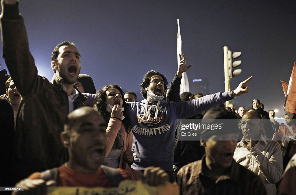 A group of Egyptian protesters chant during a demonstration in Tahrir Square on January 25, in Cairo, Egypt. Thousands of protesters converged on the capital's iconic Tahrir Square on January 25, to mark the second anniversary of the overthrow of former President Hosni Mubarak's regime. (Photo by Ed Giles/Getty Images).