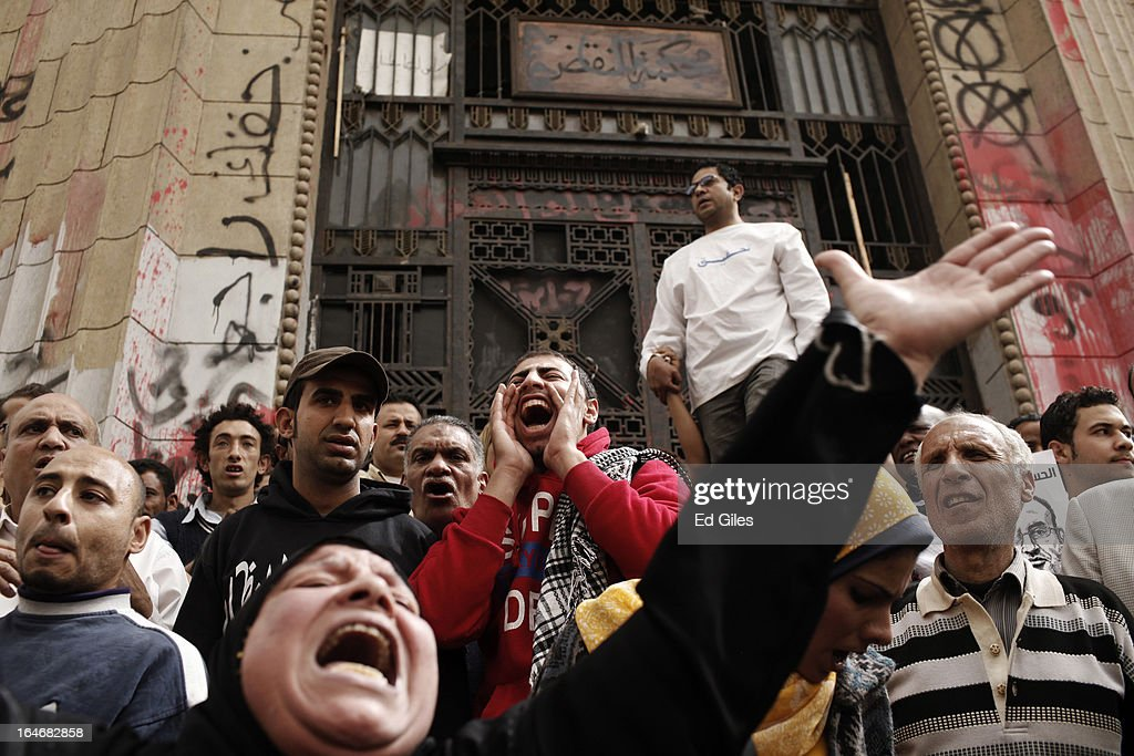 A group of Egyptian protesters gather in front of Cairo's High Court to protest against the summons of five high profile activists on March 26, 2013 in Cairo, Egypt. Five high profile Egyptian activists were summoned by the Egyptian Prosecutor General's office on charges of inciting violent clashes between opposition protesters and supporters of the Muslim Brotherhood in the Cairo suburb of Muqattam on March 22. Those charged include renowned blogger Alaa Abdel Fattah, Popular Current member Ahmed Doma, National Salvation Front member Hazem Abdel-Azim, Constitution Party member Ahmed Eid, activist Karim El-Shaer, and journalist and blogger Nawara Negm.