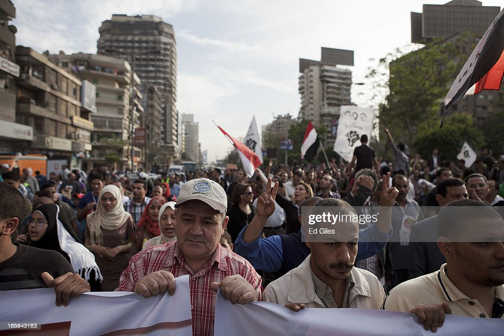 A group of Egyptian protesters march through the Cairo suburb of Mohandessen during a demonstration against Egyptian President Mohammed Morsi and the government of the Muslim Brotherhood on April 6, 2013 in Cairo, Egypt. Hundreds of protesters gathered at multiple locations across Cairo and other cities in Egypt to mark the fifth anniversary of the April 6 movement, a major revolutionary group made up of youth and workers in Egypt.