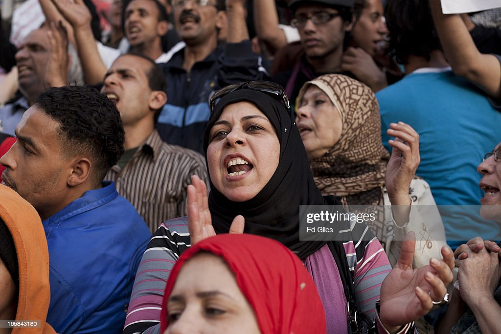 A group of Egyptian protesters sing chants during a demonstration at the Cairo High Court building against Egyptian President Mohammed Morsi and the government of the Muslim Brotherhood on April 6, 2013 in Cairo, Egypt. Hundreds of protesters gathered at multiple locations across Cairo and other cities in Egypt to mark the fifth anniversary of the April 6 movement, a major revolutionary group made up of youth and workers in Egypt.
