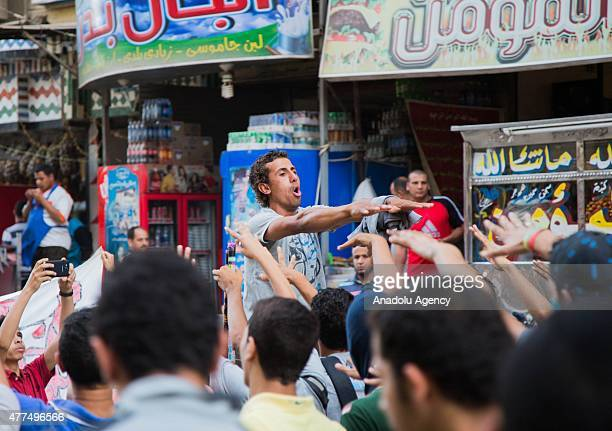 A group of Egyptian shout slogans and hold banners as they stage demonstration after the Egyptian court sentenced the Egypts first democratically...