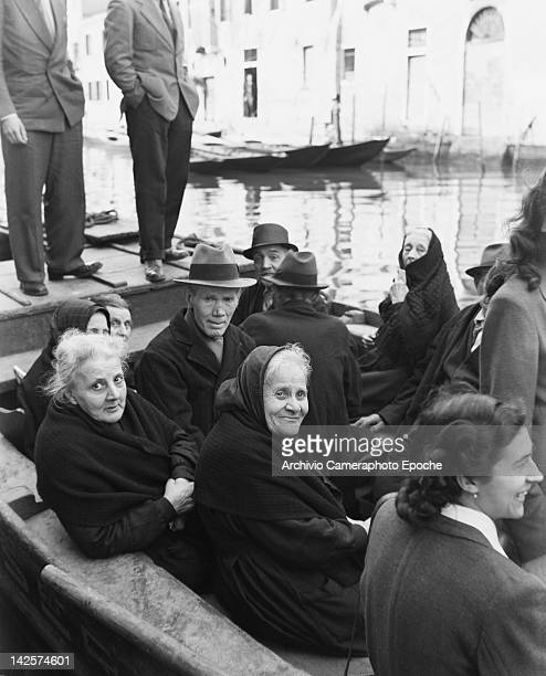 A group of elderly people on a canal boat in Italy during the general election 18th April 1948