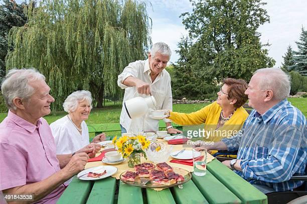 Group of elderly people oudoors in the garden