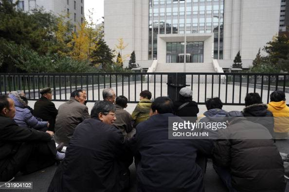 A group of elderly retirees from the Prison department in northeast China's Liaoning province stage a sitdown protest outside the Chinese Ministry of...