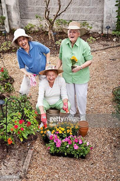 Group of elderly women gardening