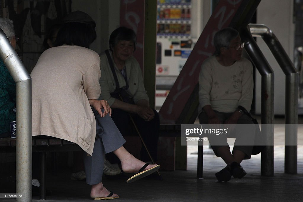 A group of elderly women rest on benches at a local housing complex in Kashiwa City, Chiba Prefecture, Japan, on Thursday, June 28, 2012. Japan ages faster than any other developed society, with 23 percent of the population 65 or older, according to government figures. Photographer: Kiyoshi Ota/Bloomberg via Getty Images