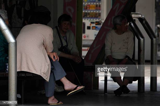 A group of elderly women rest on benches at a local housing complex in Kashiwa City Chiba Prefecture Japan on Thursday June 28 2012 Japan ages faster...