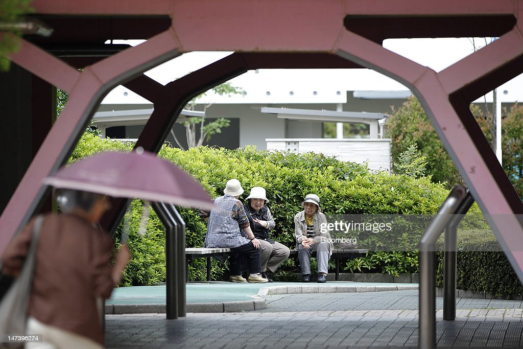 A group of elderly women rest outside a local housing complex in Kashiwa City, Chiba Prefecture, Japan, on Thursday, June 28, 2012. Japan ages faster than any other developed society, with 23 percent of the population 65 or older, according to government figures. Photographer: Kiyoshi Ota/Bloomberg via Getty Images
