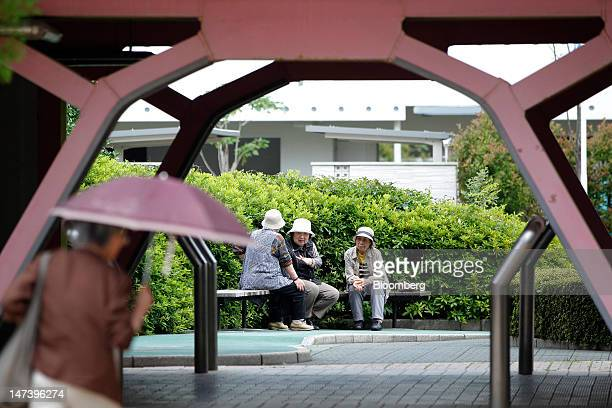A group of elderly women rest outside a local housing complex in Kashiwa City Chiba Prefecture Japan on Thursday June 28 2012 Japan ages faster than...
