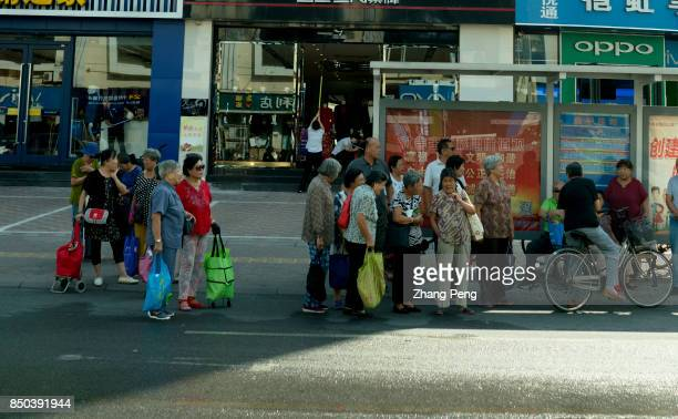 A group of elderly women wait on a bus station after morning shopping China has a fastest growing elderly population According to United Nations...