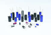 Electrolytic Capacitors, multi color and many sizes, isolated on white background, Electronics part concept.