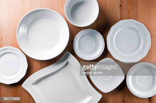 Group of elegant china, everyday ceramics tableware on wooden table