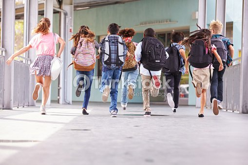 e353e348884 Group of elementary school kids running at school, back view   Stock Photo
