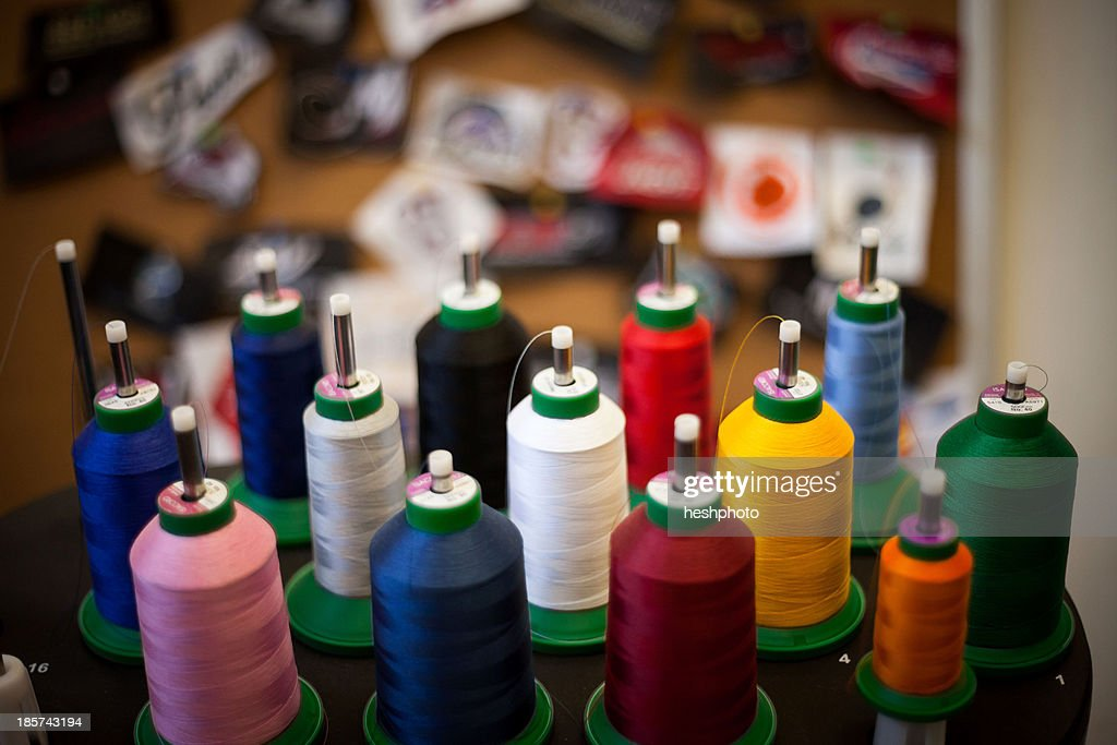 Group of embroidery thread bobbins on machine