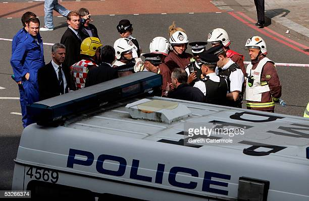 A group of emergency workers gather on Shoreditch High Street a short distance from the number 26 bus on the closed Hackney Road in Bethnal Green on...