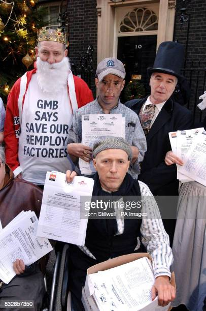 A group of employees from several Remploy factories stand outside number 10 Downing Street to hand in a petition to protest against feared closures...