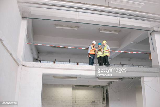 Group of engineers and architects supervising construction