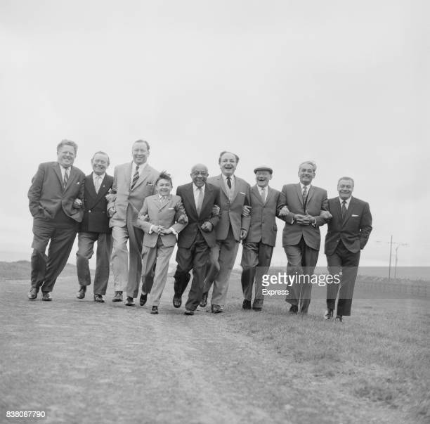 A group of entertainers walk arm in arm while attending a lunch organised by the Daily Express Blackpool 16th July 1963 From left to right tenor and...
