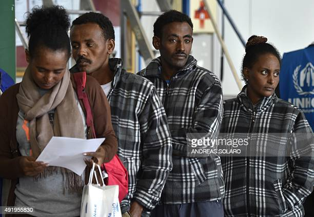 A group of Eritrean refugees prepare to board a plane to travel to Sweden as part of a new programme of the European Union to relocate refugees on...