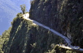 A group of European tourists ride their bicycles down the 'Death Road' near La Paz on July 18 2013 Many tourists mostly Europeans climb down with...