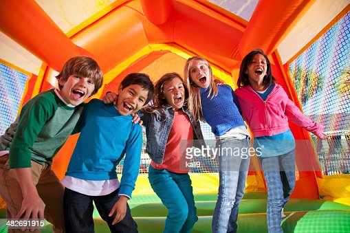 Group of excited children in bouncy house