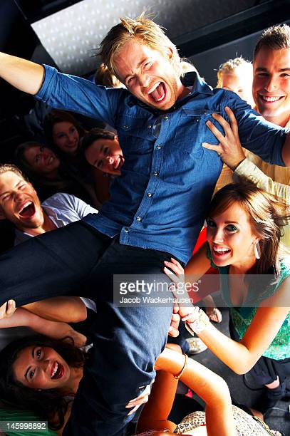 Group of excited young people enjoying in night club
