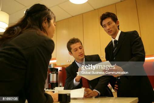 Group of executives having a discussion, low angle view : Stock Photo