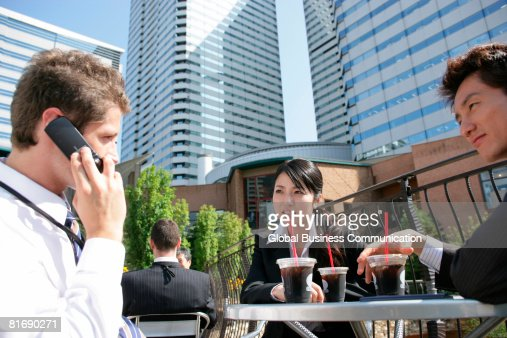 Group of executives having drinks : Stock Photo
