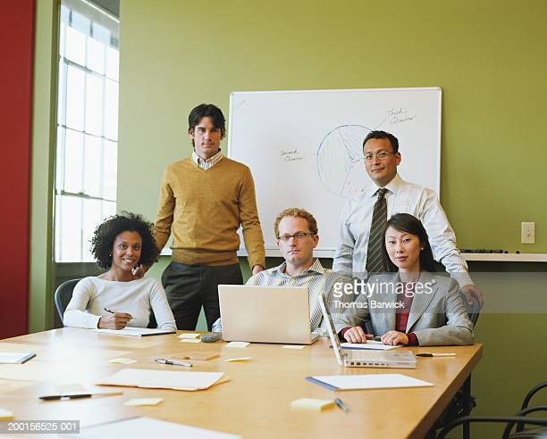 Group of executives in boardroom, portrait