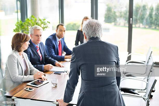 Group of executives meeting around a table