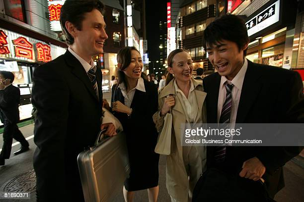 Group of executives walking on the street at night