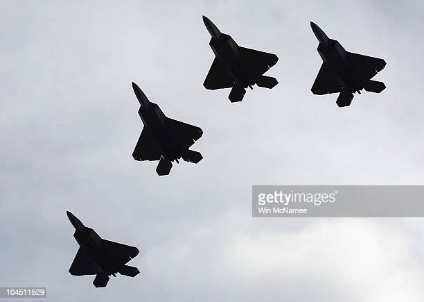 A group of F22 Raptors perform a flyover during the burial service for former Sen Ted Stevens at Arlington National Cemetery September 28 2010 in...
