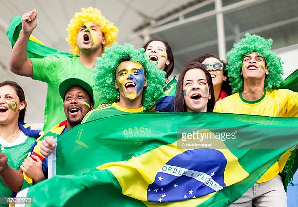 Group of fans cheering Brazil at a Football Match