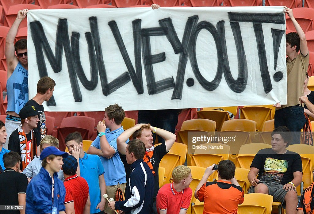 A group of fans hold up a controversial sign showing their dislike to the recent signing of Roar coach Mike Mulvey to a two year contract with the club, during the round 21 A-League match between the Brisbane Roar and the Wellington Phoenix at Suncorp Stadium on February 17, 2013 in Brisbane, Australia.
