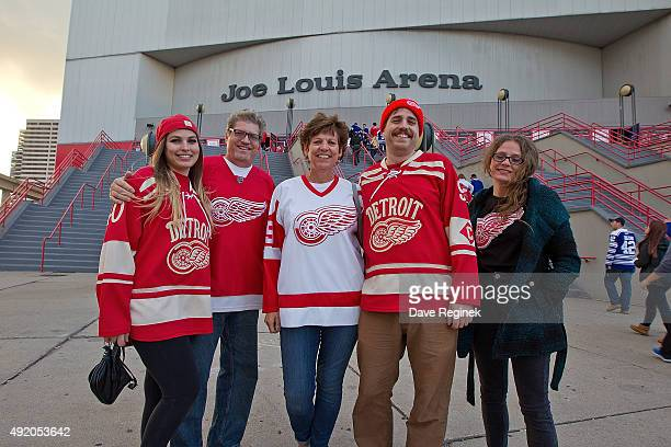 A group of fans pose prior to an NHL game between the Detroit Red Wings and the Toronto Maple Leafs at Joe Louis Arena on October 9 2015 in Detroit...