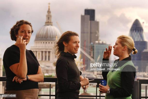 A group of female British American Tobacco employees take a cigarette break in the company's new rooftop smokers area at Globe House in the City of...