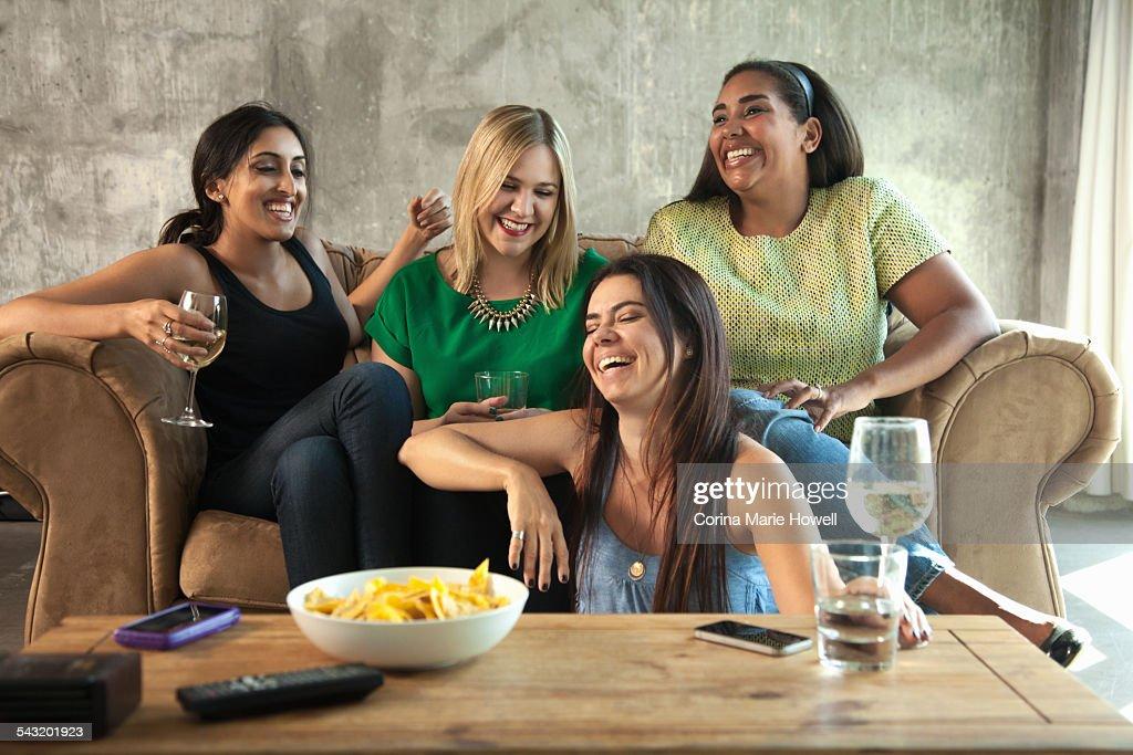 Group of female friends having girls night in