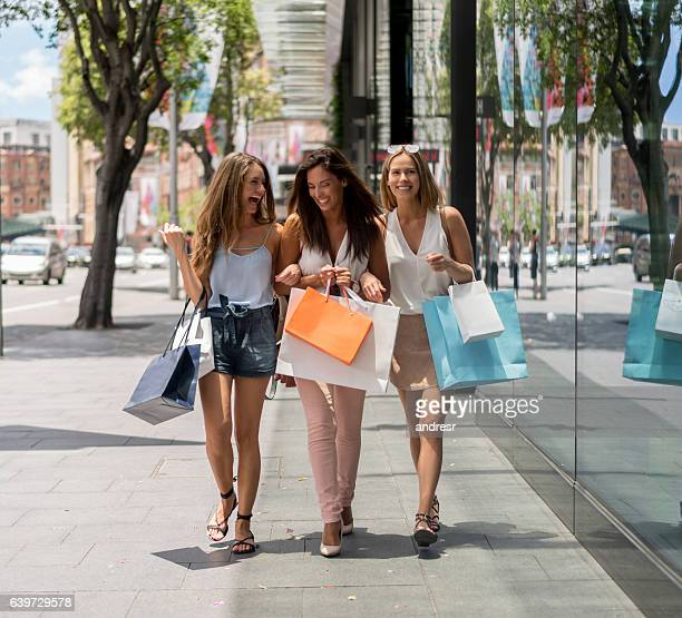 Group of female shoppers having fun