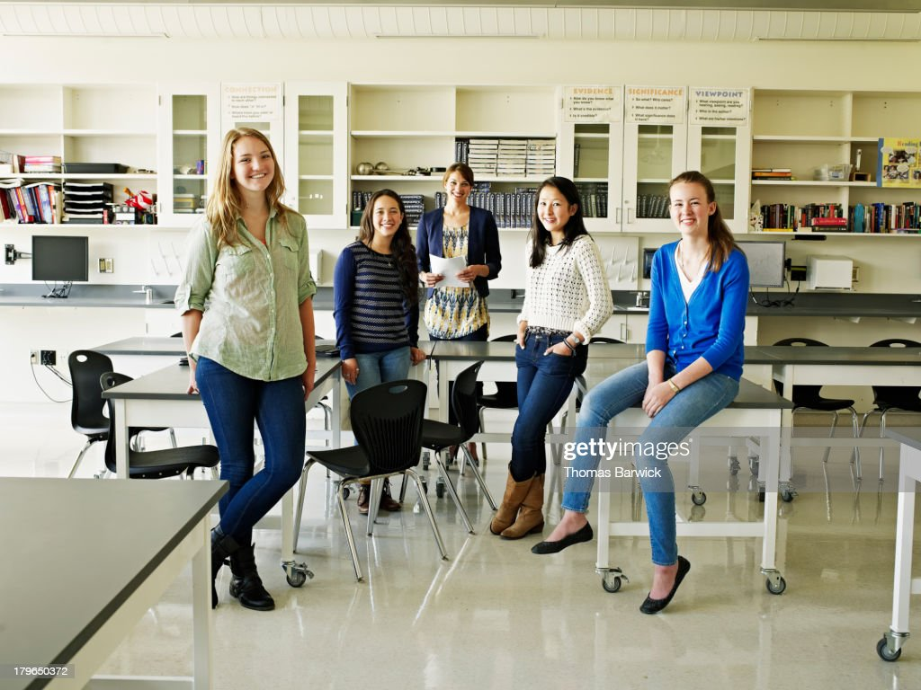 Group of female students and teacher in lab : Stock Photo