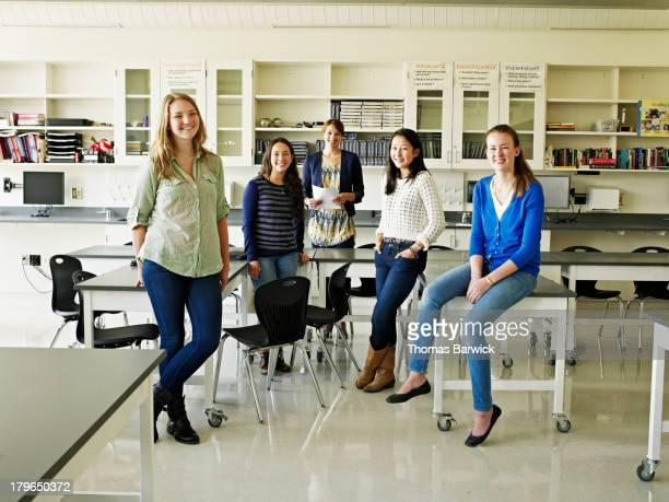 Group of female students and teacher in lab