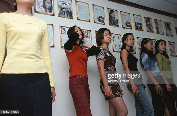 A group of female students at Sapor's Modeling School practice catwalk technique during class