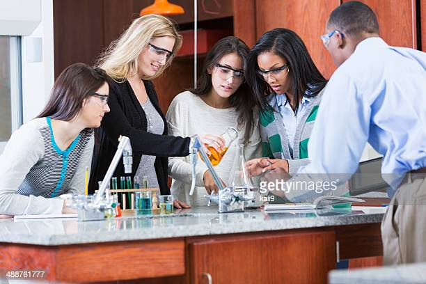 Group of female students in science class with male instructor