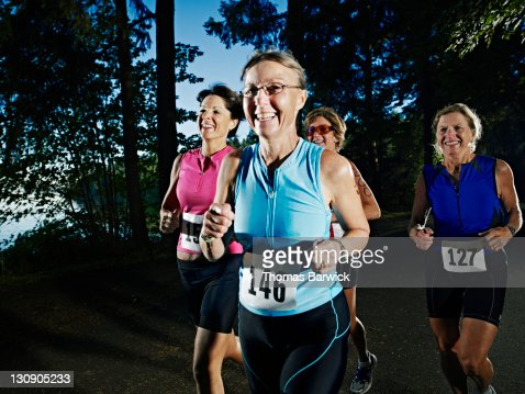 Group of female triathletes running race in group
