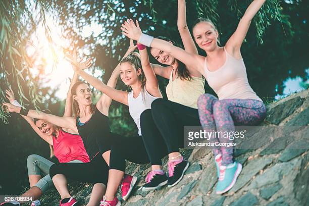 Group of Female with Raised Hands After Exercise in Nature