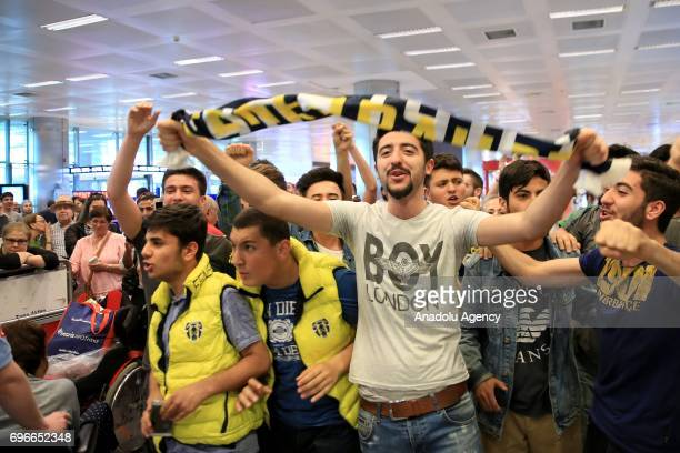 A group of Fenerbahce fans welcome Moroccan footballer Nabil Dirar as he arrives at Ataturk International Airport in Istanbul Turkey on June 16 2017