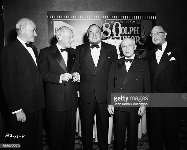 A group of filmmakers including Adolph Zukor Cecil B DeMille and Sam Goldwyn at a party celebrating the 80th birthday of Adolph Zukor for Paramount...